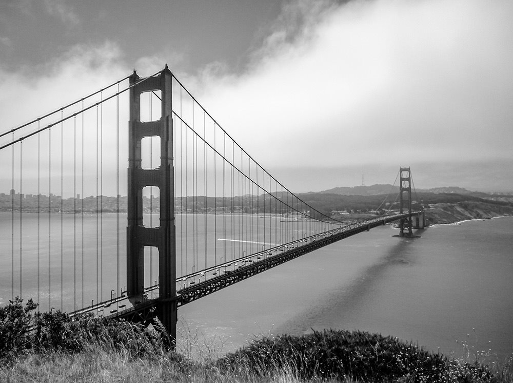 the view from battery spence of the golden gate bridge shot in black and white